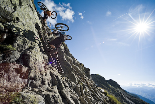 You dont get anything for free nowadays. Ladders are part of AM riding in the Alps. Photo by Dan Milner.