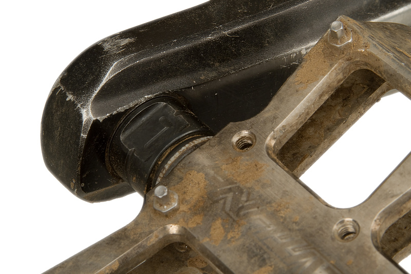Some pedals have four wrench flats which will make it easier to position the pedal wrench in the correct spot. Some also have a 6 mm or 8 mm allen access in the backside of the spindle. These pedals only have two wrench flats