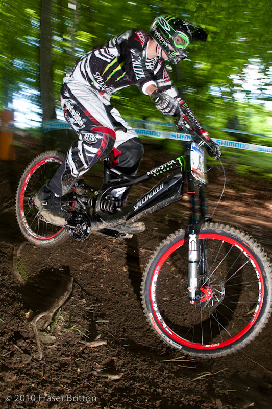 Let's get it out of the way. Specialized has a prototype downhill bike under Sam Hill and, seen here,  <br> Brendan Fairclough. It's black, it's light and it goes good and fast. No closeups allowed!