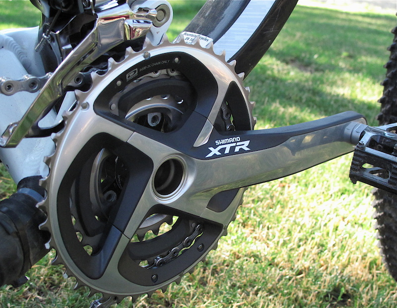 The 2011 XTR Trail crankset uses what Shimano calls CloseStep gearing - 42, 32, and a 24 tooth small ring. When teamed up with the new 11-36 XTR cassette it provides an easier low range (56.6