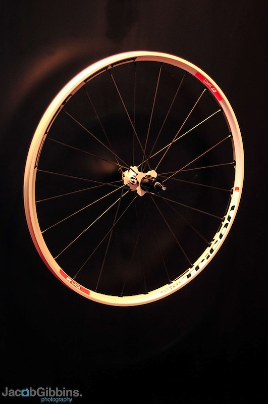  The last wheels we're going to show you are the Tricon series.  Two options with these, the XM1550 and the M1700.  Whilst both feature the same basic architecture the hubs differ in their construction, the lighter option being of a three piece design to help to prevent spokes having the effect of pulling the hub body out of shape and affecting the bearings, causing drag.  Both wheels feature the same 26mm rim which features clip in chips to hold the spokes into the undrilled, tubeless compatible, double wall rim.