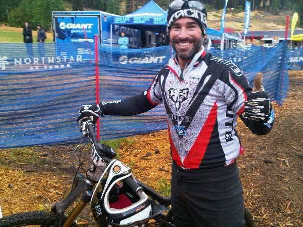 Mark Weir looking pretty happy after crossing the finish line of the 2010 Mega DH !