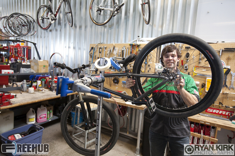 Cully Radvillas getting his bike ready as he talks with us about his work at SRAM.