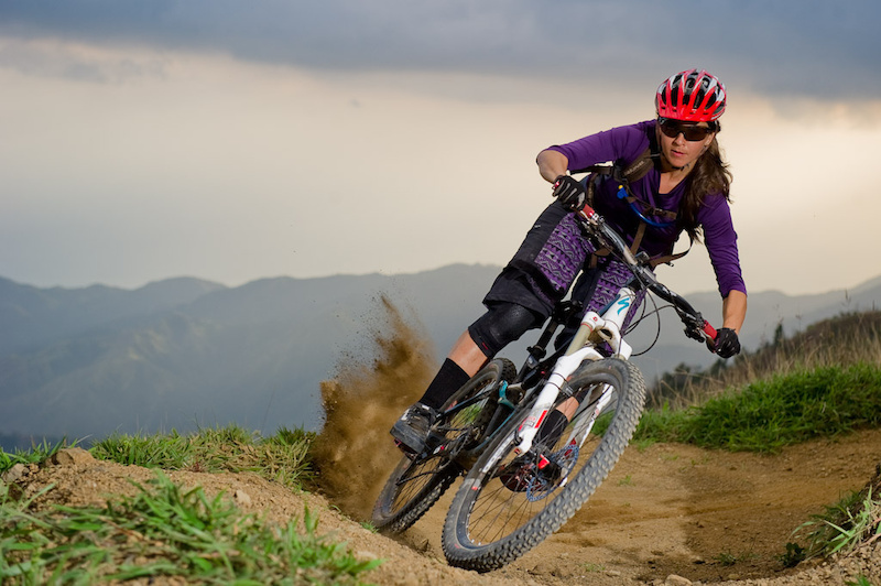 Katie Holden rides her bike on trails near Blue Mountain in Jamaica at the Jamaica Fat Tyre Festival. This was part of the memorial ride for trail builder Ken Klowak who was killed last year in Mexico.