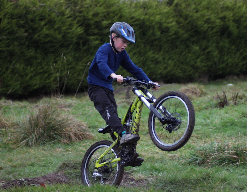 Harry Riding his new custom scott spark Jnr 20 in the garden