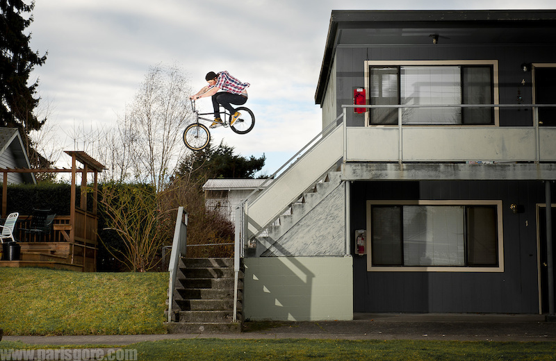 Hand rail/ stair gap near Greenlake. Josh Monteith goes big. © Paris Gore 2012