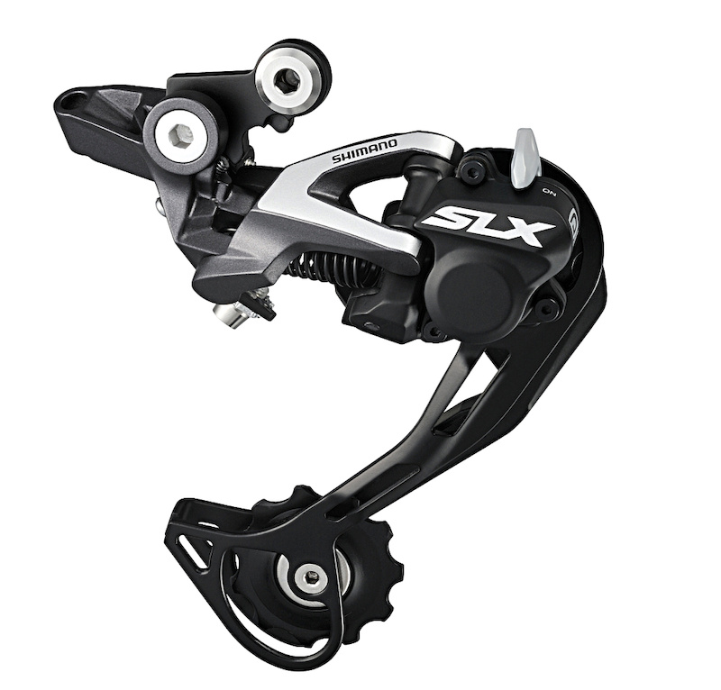 SLX rear derailleurs get the Shadow Plus friction clutch that was only released to XTR a year earlier. Insiders say that the clutch design is the second-gen version. A Non-Plus rear mech is also available. Both feature Shimano s new Direct Mount hanger that replaces the short pivot arm above the derailleur body and frame s derailleur hanger with a single sturdy link.