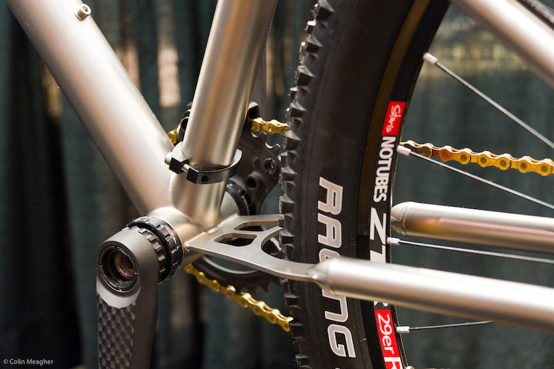 The ti chainstay is designed to flex, offering 4 inches of travel.