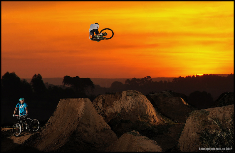 Composite image, Jumps and Rider is real,Taken with D3s this year, Un moved. Sunset with D90 was taken a while ago looking over the golf course during a bushfire. Deitys fresh blood rider Tom Hall Can Boost.