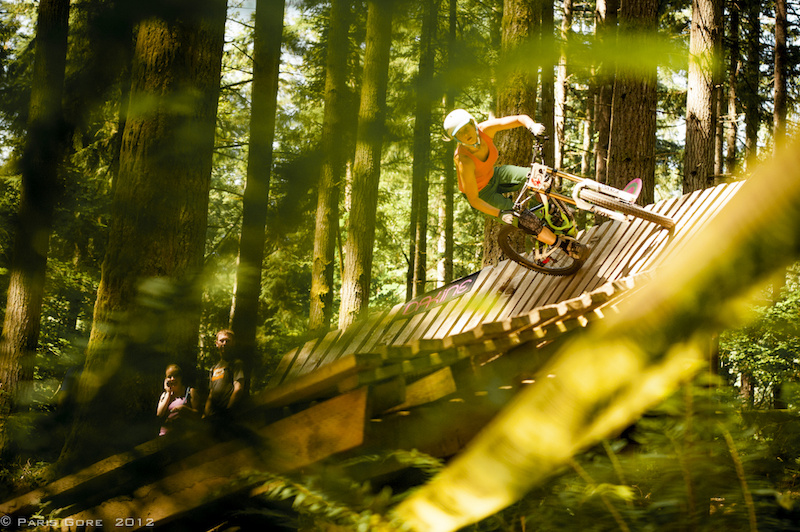 One of the only Pro women on a DH bike Lorraine was sending it huge over all the features on the pro course.