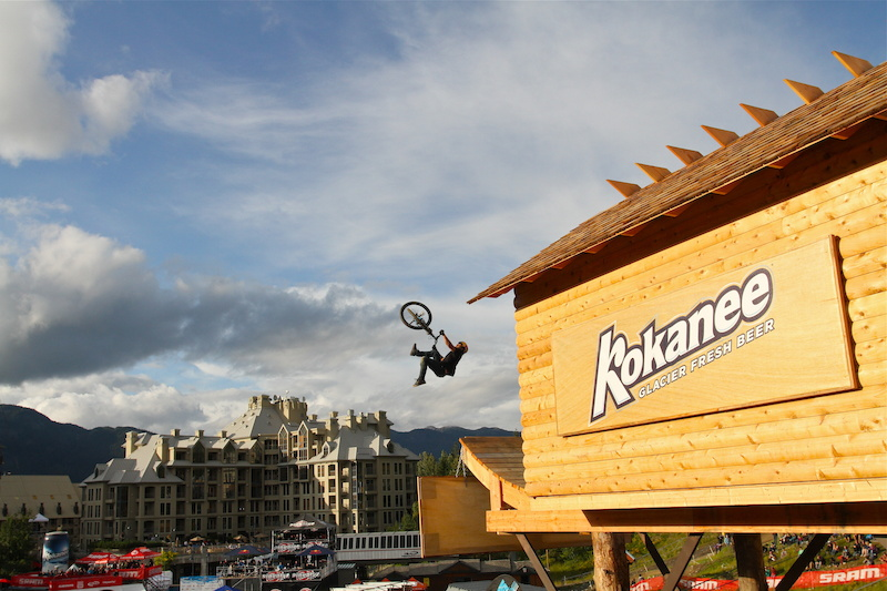 Yannick sends a wicked flip-whip off the Kokanee house during Crankworx Joyride