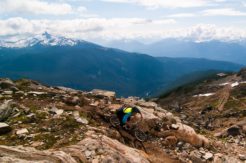 <i>Jared Vandergriend makes the first turn on the Top Of The World with Black Tusk in the background.</i>