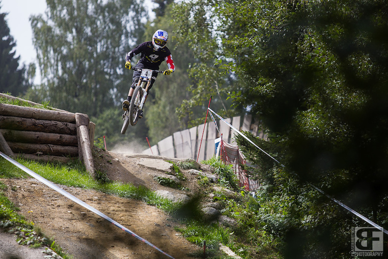 Gee Atherton on takes the smaller, faster line heading into the lower woods.