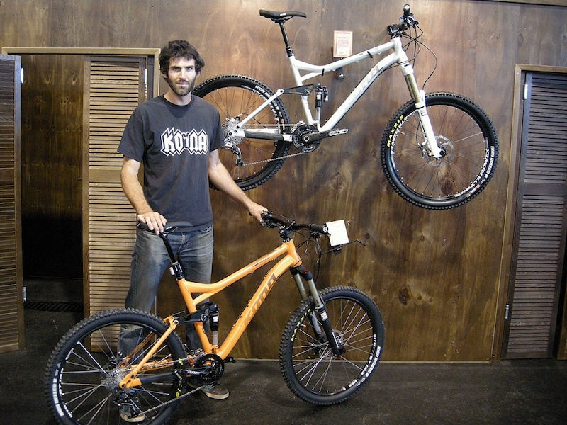 Designer Chris Mandell stands beside the Kona Process DL 2013 top and the Process
