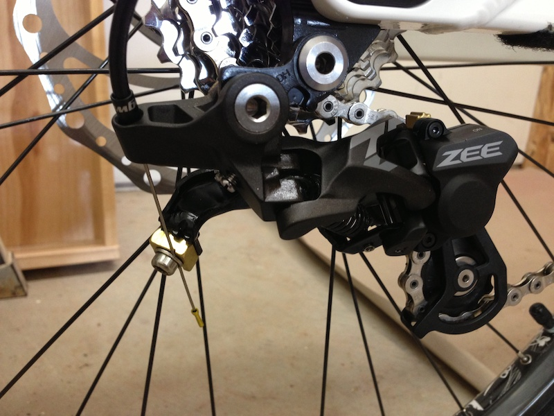 Shadow plus mod.  9spd sram shifter and drivetrain. 1/4&quot;washer with slot for cable cut down to .236&quot;