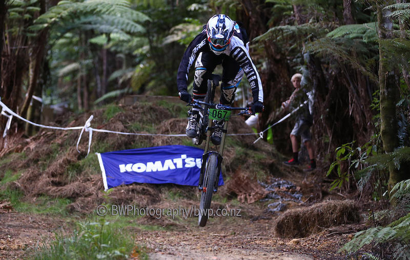 090213 Loic Bruni narrowly avoids going over the front. Bike NZ Mountain Bike Cup Series Downhill Hunua Ranges. . Photo Simon Watts bwp.co.nz bikeNZ