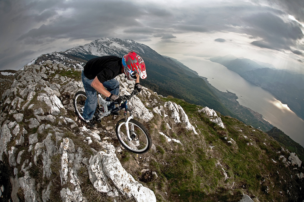 Lake Garda s local Freerider Hutch Olivieri riding the steep slope that goes on the Lake. one of the shot that I like more on my local trails.