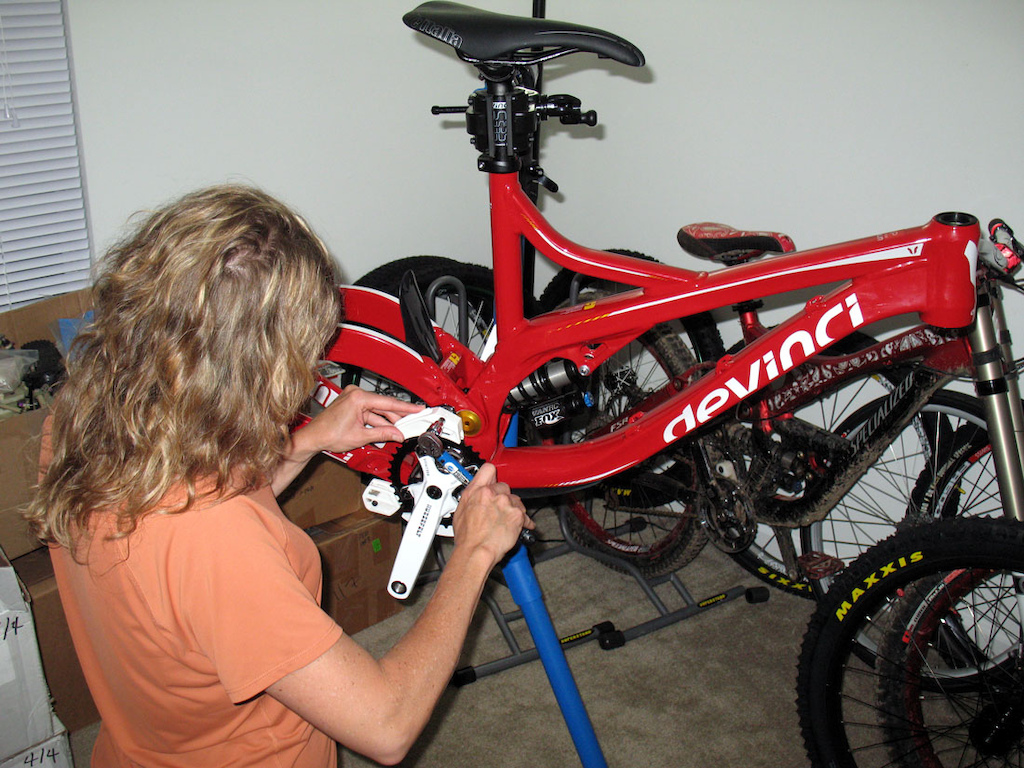 My wife pulling apart the new bike for the 2012 season in prep for some sponsor parts. Women who ride are awesome, those that build their own stuff, even better.
