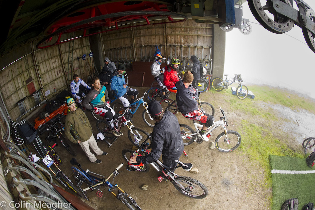 Warming up out of the rain meant using an old lift shack. With so many racers needing a place to get spun up competition for a sheltered spot was fierce. Some teams staked out space during the woment s race.