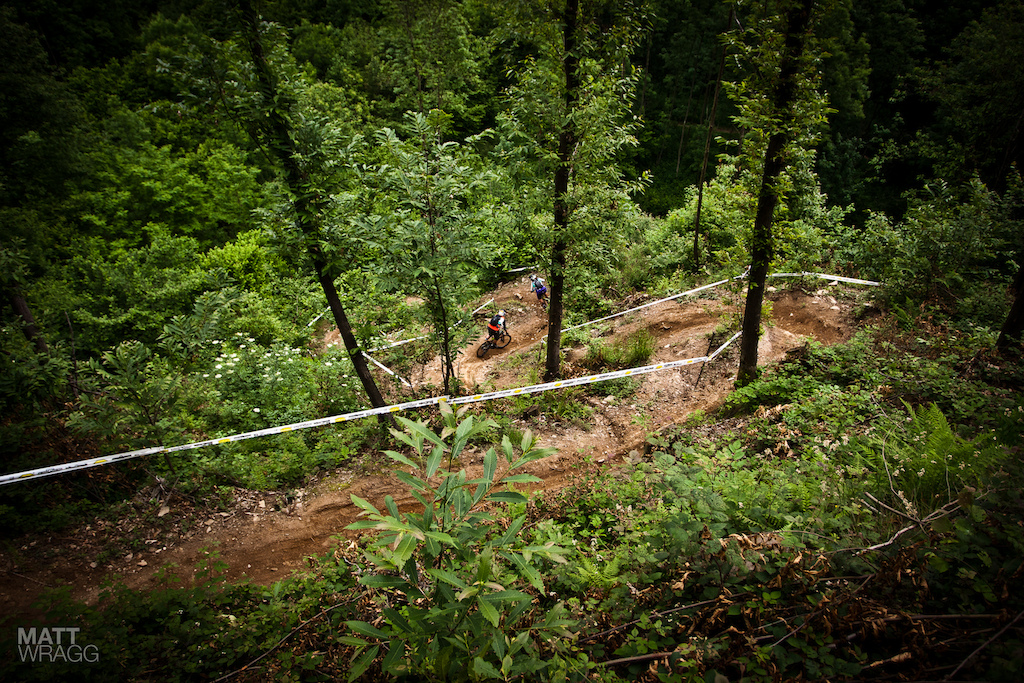 Dropping into the final curves practicing for the Pogno Superenduro.