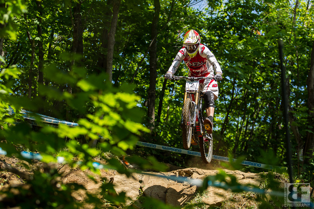 Greg Minnaar was looking fast all day as usual. Here he sends one of the upper rock drops with ease as expected.