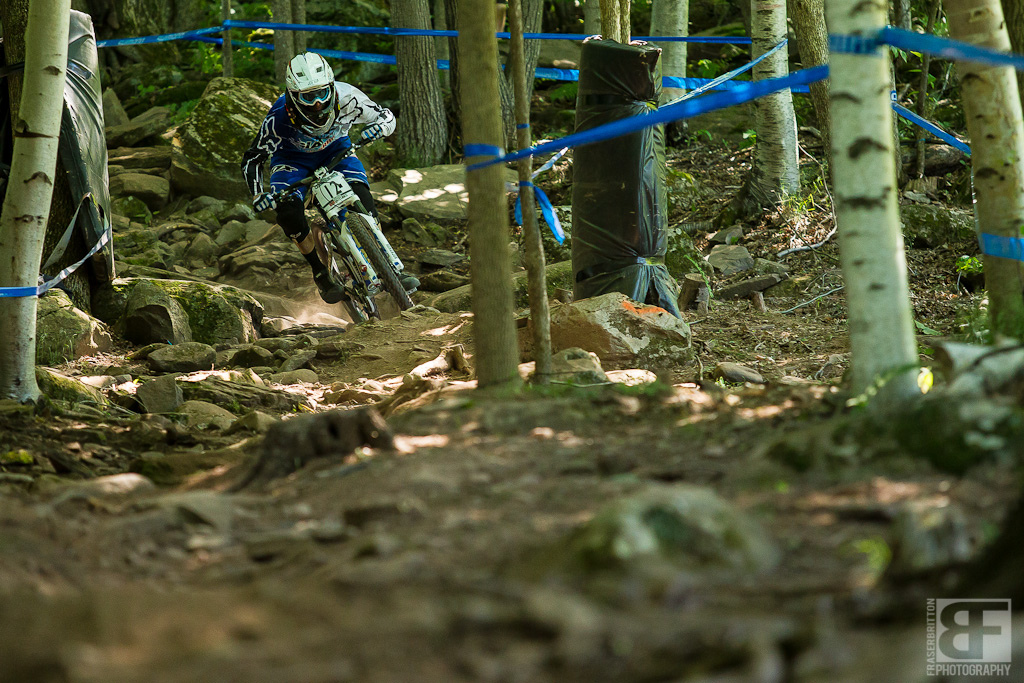 Andrew Neethling flats his rear tire as he exits the rock garden during timed training. 2 riders later Brendan did the same thing. 4 riders later another rider did the same. This track has already been brutal on rims it looks like tubes are next.