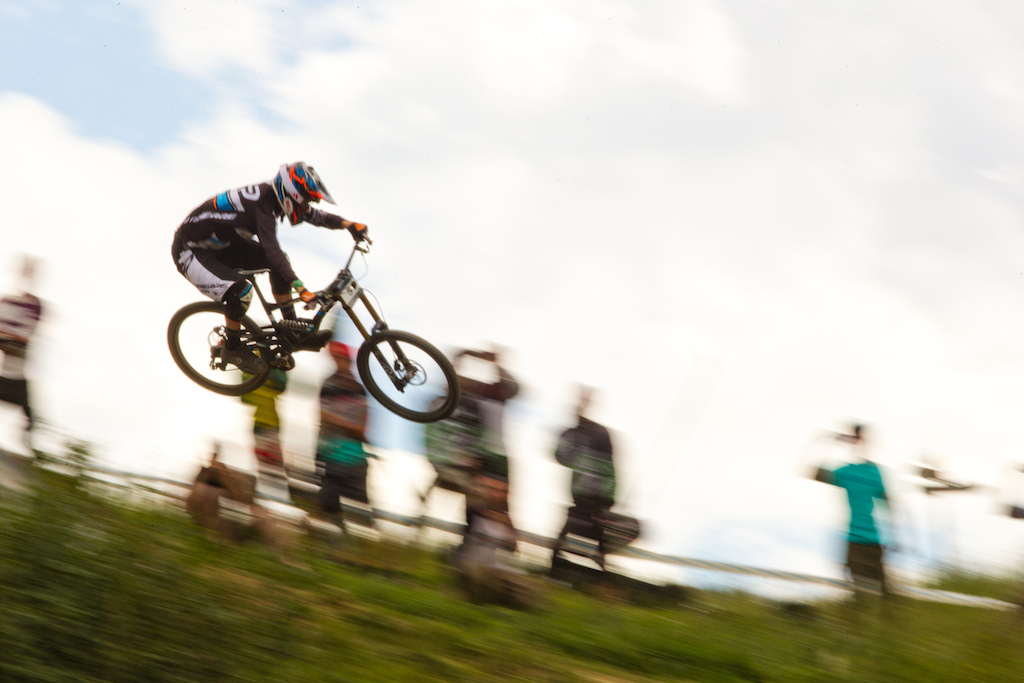 Sam Blenkinsop here is flying on one of the huge features of this Giant Air Downhill