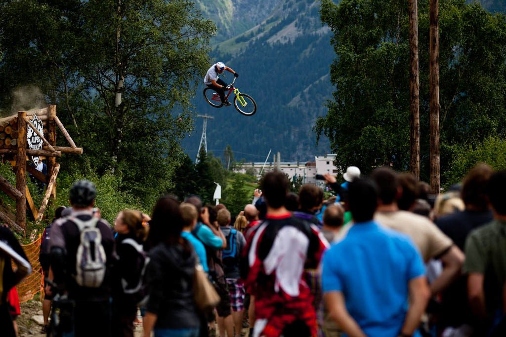 Yannick Granieri flies over the road gap during Slopestyle practice at Crankworx Les 2 Alpes