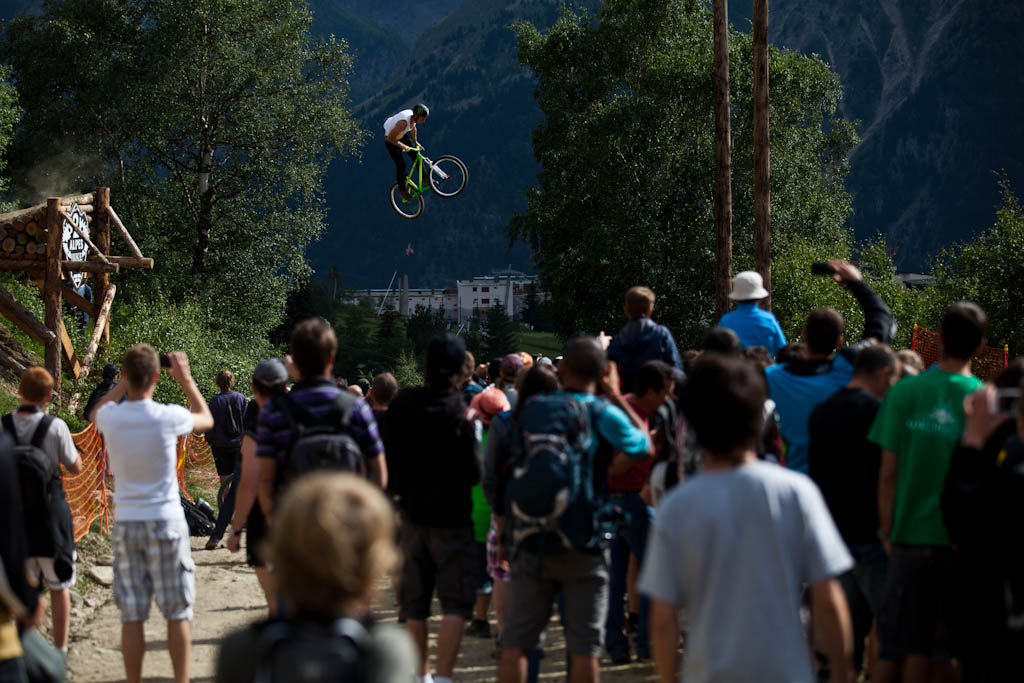 Sam Pilgrim launches over the road gap during Slopestyle practice at Crankworx Les 2 Alpes