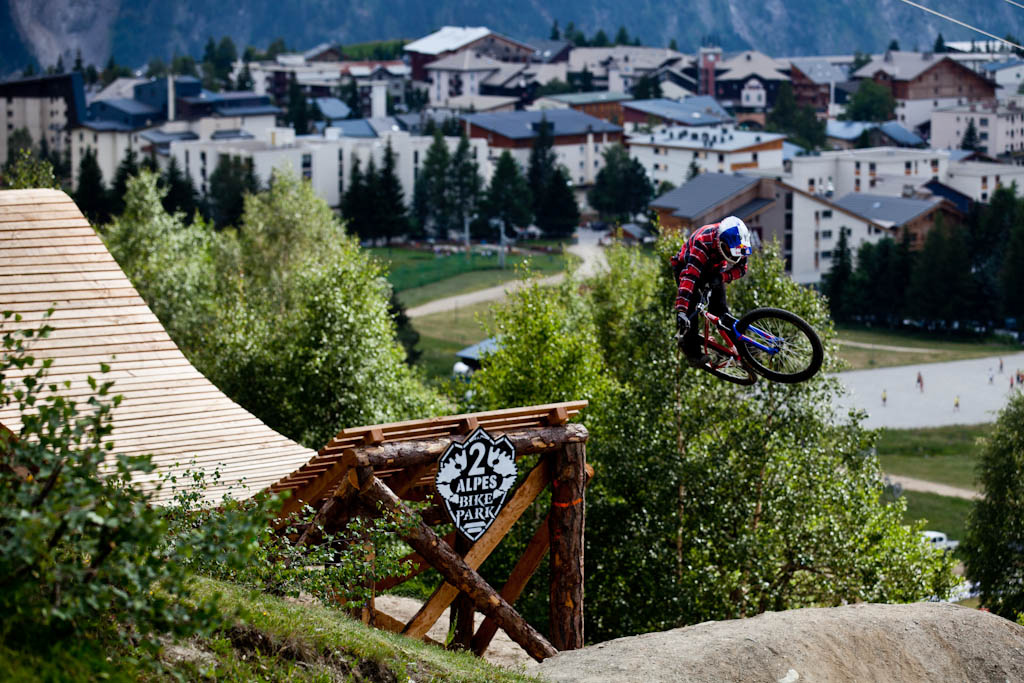Szymon Godziek with a table off the whale tail during Slopestyle practice at Crankworx Les 2 Alpes