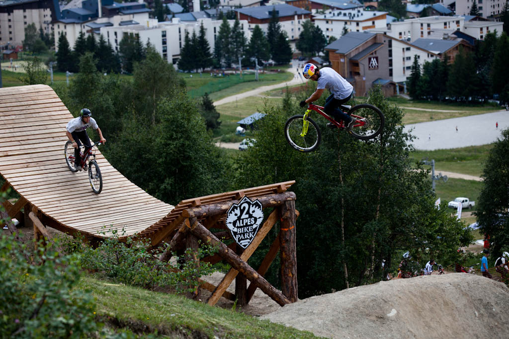 Yannick three s off the whale tail with Cam Zink following during Slopestyle practice at Crankworx Les 2 Alpes. Yannick built this course and he s ridden it more than anyone so there s no reason for him to not do well here this weekend.