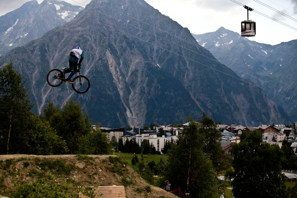 Brandon Semenuk with a stylish whip during Slopestyle practice at Crankworx Les 2 Alpes