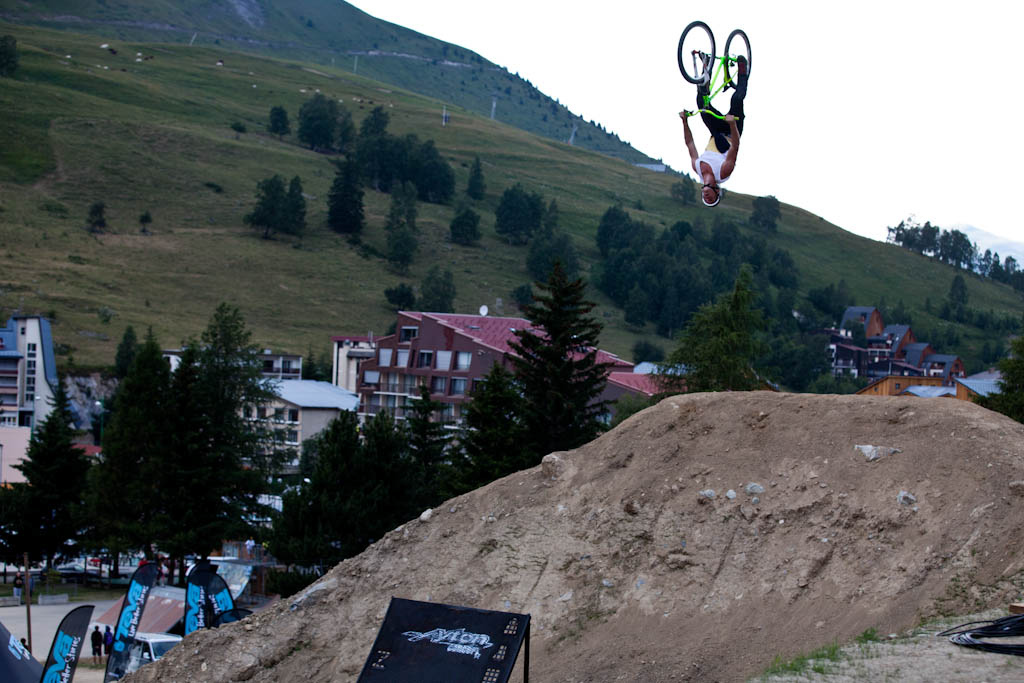 Sam Pilgrim big backflip on the last jump during Slopestyle practice at Crankworx Les 2 Alpes
