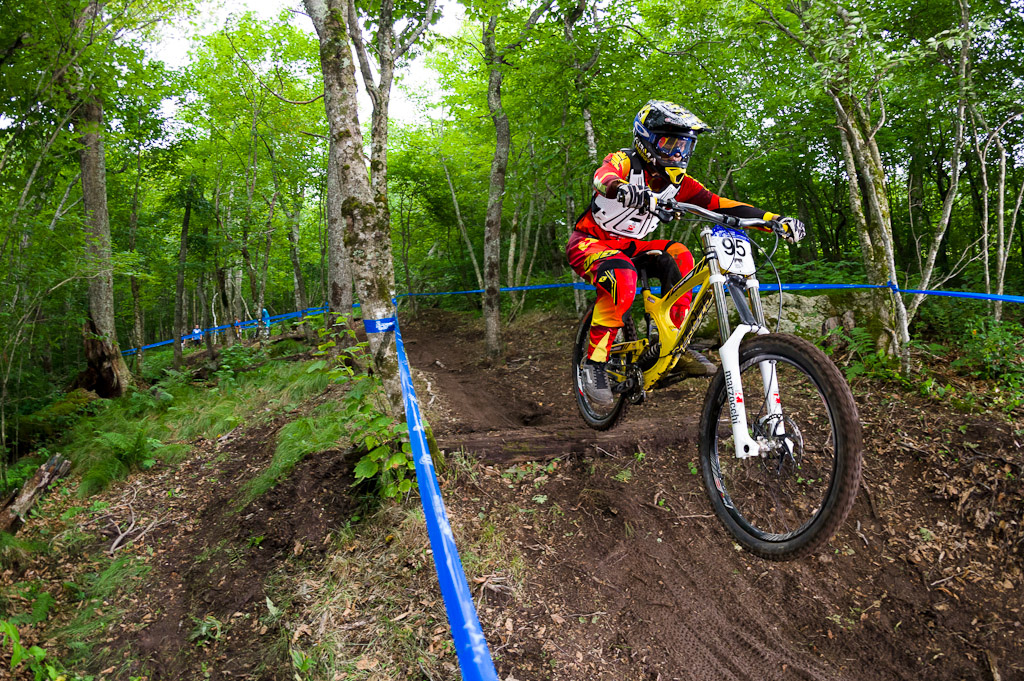 Bubba pinned through the trees and jumping into a berm. Gravity Nationals at Beech Mountain North Carolina