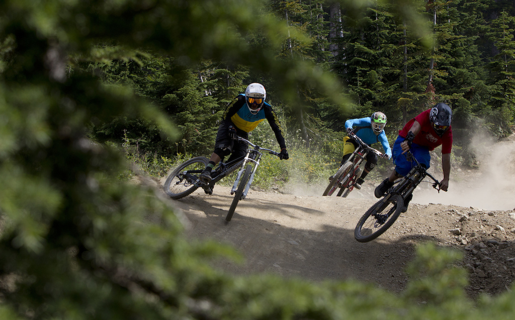 Mountain bike riders Paul Stevens Dylan Sherrard and Seb Kemp are seen riding along a trail in Whistler B.C. Monday August 13 2012. THE CANADIAN PRESS Jonathan Hayward