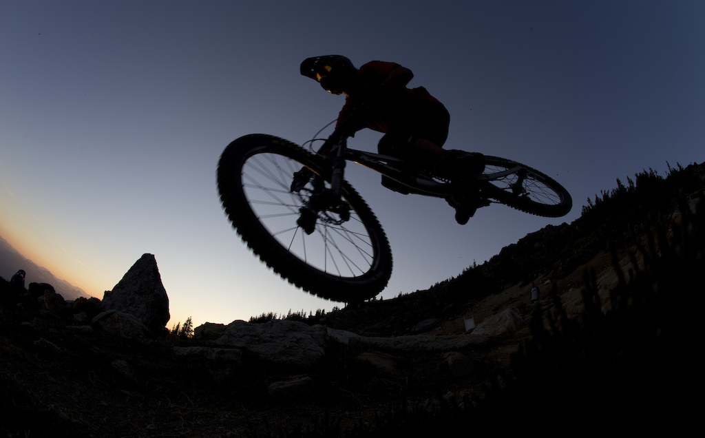 Mountain bike rider Dylan Sherrard flies through the air on the top of the world bike trail at the peak of Whistler mountain in Whistler B.C. Saturday August 11 2012. THE CANADIAN PRESS Jonathan Hayward