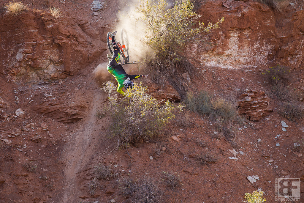 Kenny Smith was one of the favorites here at Rampage. He s known to be a big mountain destroyer but things went terribly wrong on his first run and he sailed down an 80 foot cliff. 2 black and blue ankles and Kenny is out for the weekend.