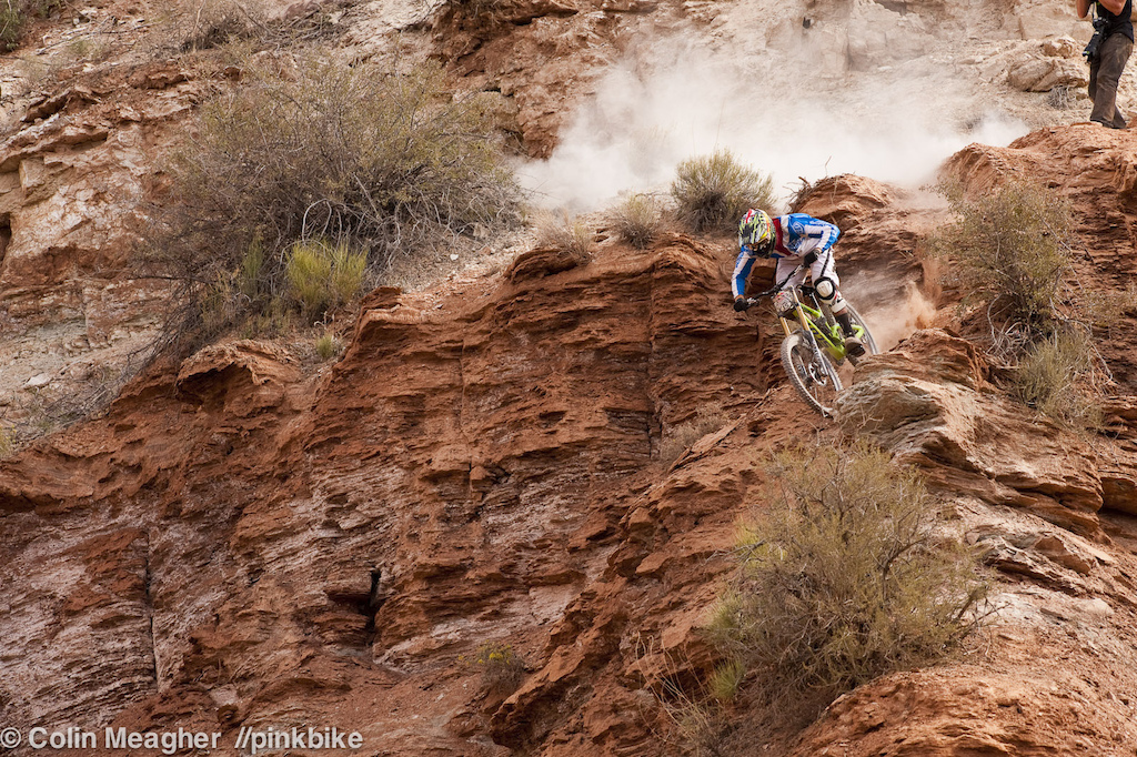 Brendan Fairclough washed out his front tire in an unexpected pile of moon dust on his first run--early am practice sessions sloughed loose dirt into his line. Bren-dawg took that in stride and then charged his second run strongly enough to qualify. Instead of launching that sick looking canyon gap he s fashioned high up on the track he opted to hit a hip a just below it. I m saving that one for Sunday s finals. It s only scary looking until you re on the lip. 