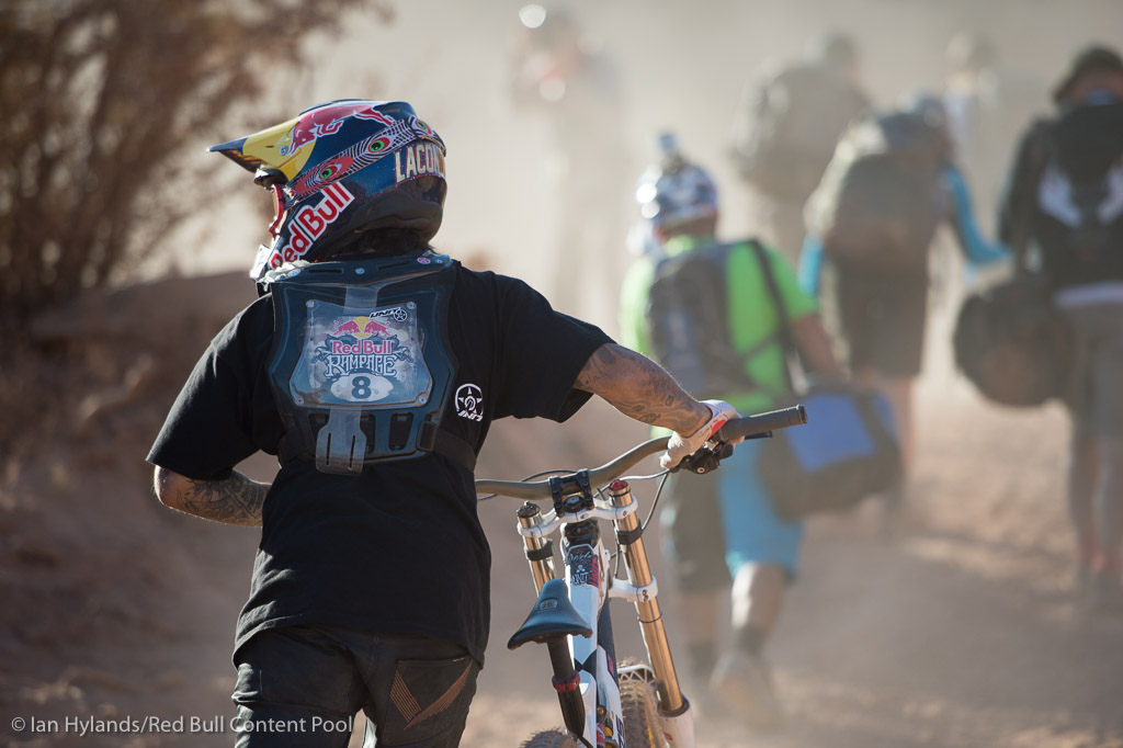 Andreu Lacondeguy pushes his bike up the hill at Red Bull Rampage in Virgin Utah on 7 October 2012