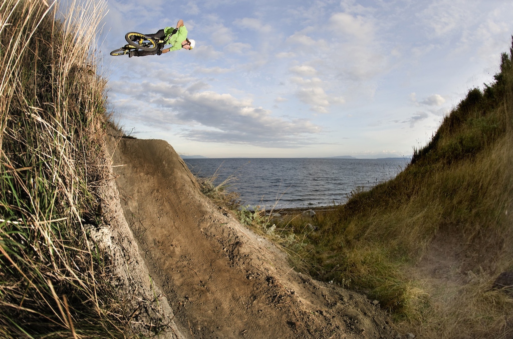 Kyle Hansen on some random sketchy built beach jump outside Courtenay on Vancouver Island Canada.