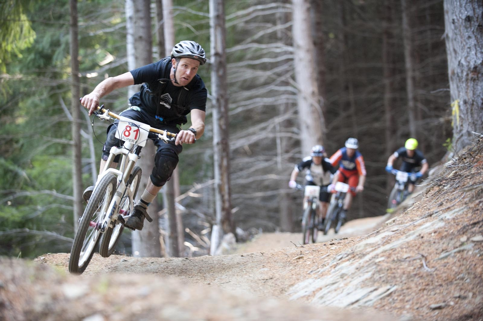 Racers compete in the Mountain Bike Super D race at the 2012 Queenstown Bike Festival