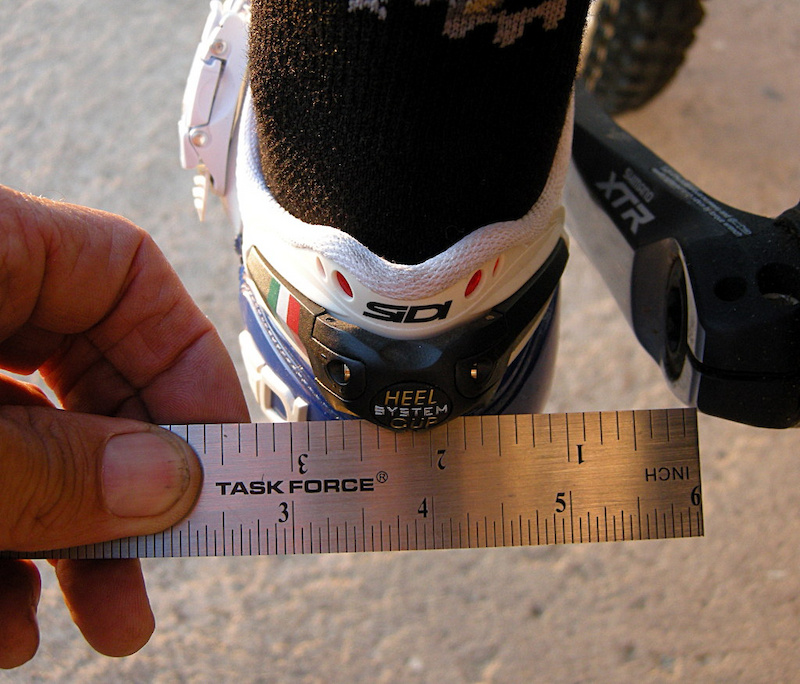 Set the crank at the forward 9-o clock position and measure the distance from the center of the crank arm to somewhere on the heel. Use this as a reference when you adjust the angle of the cleat. Make 1 4 inch 5mm adjustments to achieve best results.